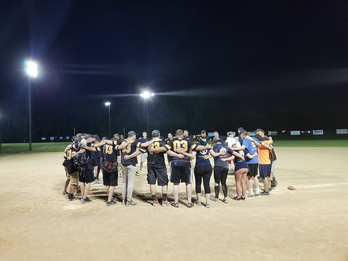 group embracing echa other after softball